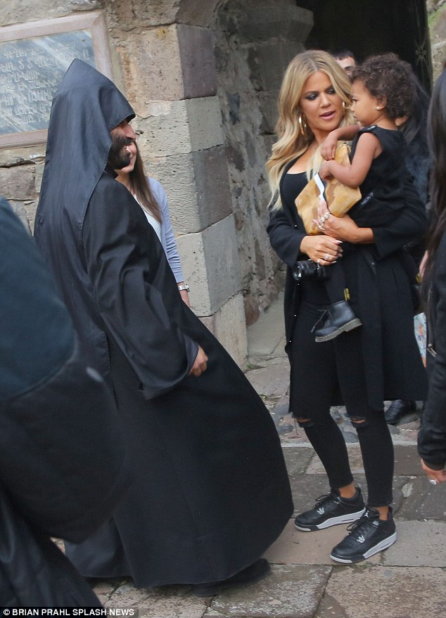 New title: Khloe was named the godmother of 22-month-old North at the child's baptism in Jerusalem after Armenia (pictured inside a sacred monestary in Armenia on April 10)